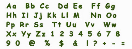 Letters made of grass. Alphabet and digits Royalty Free Stock Images