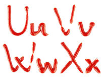 Letters made of ketchup on white background Royalty Free Stock Image