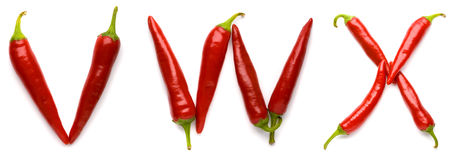 Letters made of peppers. The letters V, W and X made with red chili peppers, isolated on white background royalty free stock images