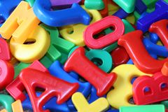 Letters and numbers. Childrens fridge magnets with letters and numbers on them stock image