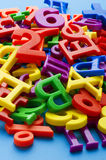 Letters and numbers on blue close up Royalty Free Stock Photo