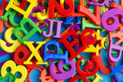 Letters and numbers on blue macro Royalty Free Stock Photography