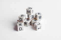 Letters and numbers on cubes white background stock photography