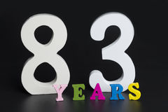 Letters and numbers eighty-three years old on a black background. Royalty Free Stock Photo
