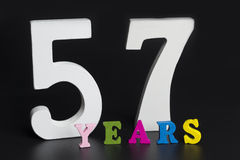 Letters and numbers-fifty-seven on a black background. Letters and numbers-fifty-seven on black isolated background Royalty Free Stock Photo