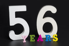 Letters and numbers-fifty six on a black background. Royalty Free Stock Photography
