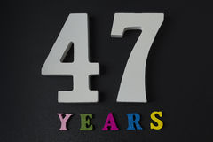 Letters and numbers-forty-seven on a black background. Letters and numbers-forty-seven on black  background Stock Photo