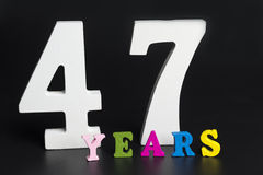 Letters and numbers-forty-seven on a black background. Stock Image