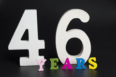 Letters and numbers forty-six years on a black background. Royalty Free Stock Image