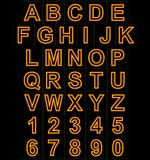 Letters and numbers neon lights outlined isolated on black Royalty Free Stock Photo