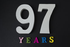 Letters and numbers ninety-seven years on a black background. Letters and numbers ninety-seven years on a black  background Royalty Free Stock Image