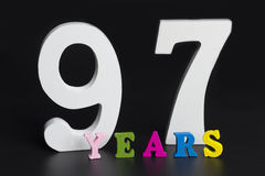 Letters and numbers ninety-seven years on a black background. Letters and numbers ninety-seven years on a black isolated background Royalty Free Stock Photos