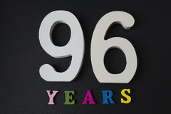 Letters and numbers ninety-six years on a black background. Royalty Free Stock Photo
