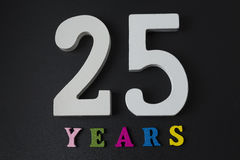Letters and numbers Pat twenty years on a black background. Royalty Free Stock Photography