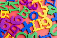 Letters and numbers on red Stock Photo