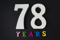 Letters and numbers seventy-eight years old on a black background. Letters and numbers seventy-eight years old on a black  background Stock Image