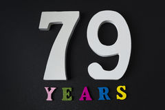 Letters and numbers seventy-nine years on a black background. Letters and numbers seventy-nine years on a black  background Stock Images