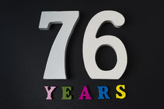 Letters and numbers seventy-six years on a black background. Letters and numbers seventy-six years on a black  background Royalty Free Stock Images