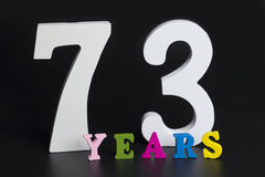 Letters and numbers-seventy-three on a black background. Royalty Free Stock Image