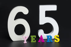 Letters and numbers sixty-five on the black background. Stock Images