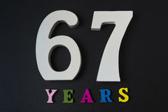 Letters and numbers-sixty-seven on a black background. Letters and numbers-sixty-seven on black  background Stock Photos