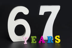 Letters and numbers-sixty-seven on a black background. Letters and numbers-sixty-seven on black isolated background Stock Image