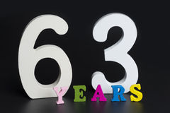 Letters and numbers-sixty-three on the black background. Stock Photography