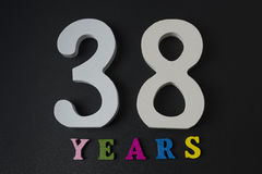 Letters and numbers thirty-eight years on a black background. Stock Images