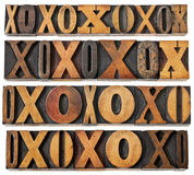 Letters O and X in wood type. Letters O and X in vintage letterpress wood type - four rows of different fonts - decoration or design elements Stock Photos