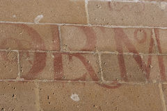 Letters painted on a stone wall Renaissance (vitores), Ubeda Stock Photos