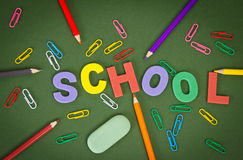 Letters with pencils, paper clips, by an eraser Stock Image