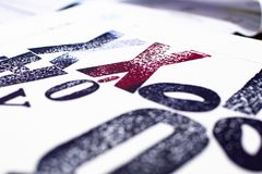 letters printed with movable type and traditional letterpress printing. blue and red letters printed with letterpress on white stock photography