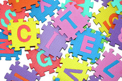 Letters-puzzle. Bunch of letters-puzzle, isolated on white background Royalty Free Stock Photography