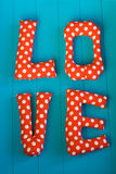 The letters with red polka dot fabric Stock Image