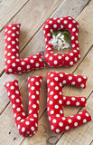 The letters with red polka dot fabric Royalty Free Stock Images