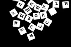 The letters of the Russian alphabet for a child`s game scattered on a dark background. Close up royalty free stock photo