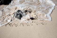Letters on the sand in Mauritius Royalty Free Stock Photography