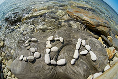 Letters Sea on stone of seashore Royalty Free Stock Photography