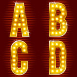 Letters for signs with lamps. A set of symbols for signs, such as a casino or cinema in the form of letters with lamps Stock Images