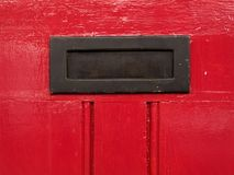 Letters slot. Red door detail Royalty Free Stock Images