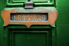Letters Slot on Green Door Royalty Free Stock Images