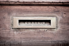 Letters slot at Old Wooden Door in Lisbon Royalty Free Stock Photography