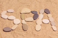 Letters SPA on the sand Royalty Free Stock Photos