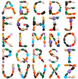 Letters spelled with semiprecious stones Stock Photos