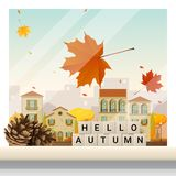 Letters spelling hello autumn on wooden table top with autumn cityscape background Royalty Free Stock Photos