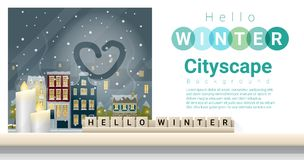 Letters spelling hello winter on wooden table top with winter cityscape background Royalty Free Stock Photography