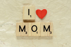 Letters spelling I love mom Stock Images