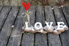 Letters spelling out the word love. Wooden letters spelling out the word love, outdoor image Royalty Free Stock Photos
