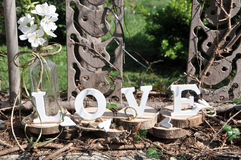 Letters spelling out the word love. Wooden letters spelling out the word love, outdoor image Stock Photo