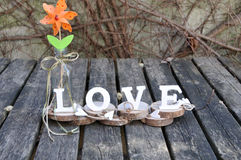 Letters spelling out the word love. Wooden letters spelling out the word love, outdoor image Royalty Free Stock Images